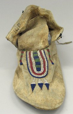 Blackfoot (Native American). Moccasin with Red, White Blue and Green Beading, 1880-1890. Hide, beads, 3 3/4 x 4 5/16 x 10 13/16in. (9.5 x 11 x 27.5cm). Brooklyn Museum, Robert B. Woodward Memorial Fund, 26.797. Creative Commons-BY