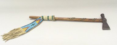 Oglala, Lakota, Sioux (Native American). Tomahawk, late 19th-early 20th century. Wood, buckskin, beads, metal, Tomahawk: 22 7/16 x 6 11/16 in. (57 x 17 cm). Brooklyn Museum, Robert B. Woodward Memorial Fund, 26.802. Creative Commons-BY
