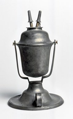 American. Lamp, ca. 1840. Pewter, 8 3/8 x 5 1/4 x 5 1/4 in. (21.3 x 13.3 x 13.3 cm). Brooklyn Museum, Gift of Mrs. Samuel Doughty, 27.521. Creative Commons-BY