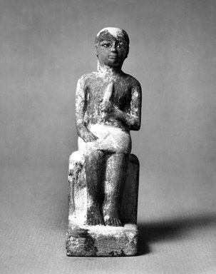 Statuette of Seated Man Clasping a Lotus Blossom, ca. 1352-1336 B.C.E. Limestone, painted, 3 1/2 x 1 1/16 x 2 1/4 in. (8.9 x 2.7 x 5.7 cm). Brooklyn Museum, Gift of the Egypt Exploration Society, 29.1310. Creative Commons-BY