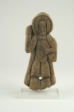 Coptic. Figure of a Saint Holding Book in Left Hand, ca. 3rd-6th century C.E. Wood, 3 3/8 x 3/4 x 8 9/16 in. (8.6 x 1.9 x 21.8 cm). Brooklyn Museum, Gift of Ruth Tishner Costantino, 30.27. Creative Commons-BY