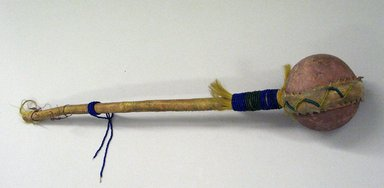 Blackfoot (Native American). War Club, 19th century. Stone, wood, hide, beads, 25 in. with stone hammer 4 in. (63.5 x 10.2 cm). Brooklyn Museum, Bequest of W.S. Morton Mead, 32.2099.32569. Creative Commons-BY