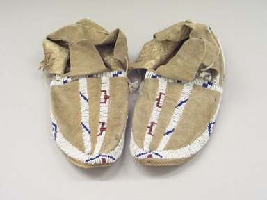 Blackfoot (Native American). Pair of Beaded Moccasins. Beads, buckskin Brooklyn Museum, Bequest of W.S. Morton Mead, 32.2099.32573a-b. Creative Commons-BY