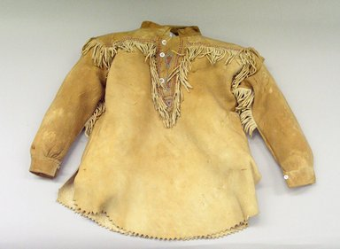 Possibly Blackfoot or (Native American). Boy's Shirt with Triangular Inset and Stylized Leaf Design, 1920-1940. Buckskin, beads, plastic buttons, cotton thread, 15 x 22 in (38 x 56 cm). Brooklyn Museum, Bequest of W.S. Morton Mead, 32.2099.32577. Creative Commons-BY