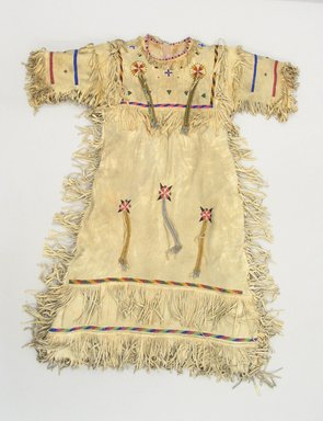 Blackfoot (Native American). Fringed and Beaded Dress, early 20th century. Buckskin, beads Brooklyn Museum, Bequest of W.S. Morton Mead, 32.2099.32583. Creative Commons-BY