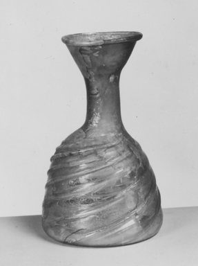 Roman. Bottle, 1st - 5th century C.E. Glass, 4 5/16 x Diam. 2 5/8 in. (11 x 6.7 cm). Brooklyn Museum, Brooklyn Museum Collection, 34.5581. Creative Commons-BY