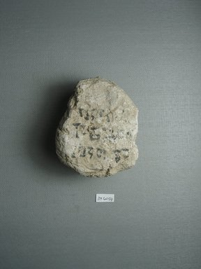 Brooklyn Museum: Small Lump of Plaster with Black Ink Inscription