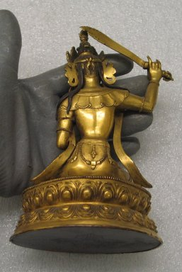 Small Lamaist Figure of Manjusri, 18th-19th century. Gilded copper, 6 5/16 x 4 5/16 in. (16 x 11 cm). Brooklyn Museum, Brooklyn Museum Collection, 34.799. Creative Commons-BY