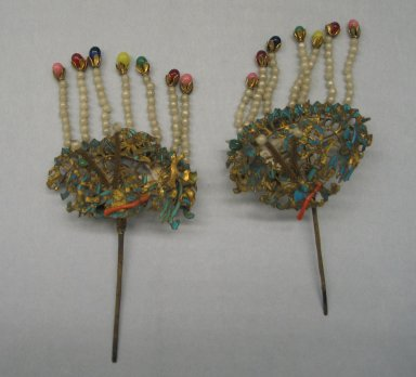 Hair Ornament, 19th century. Gilded brass, coral, beads, kingfisher's feather, Each: 2 3/8 x 4 15/16 in. (6 x 12.5 cm). Brooklyn Museum, Brooklyn Museum Collection, 34.937. Creative Commons-BY