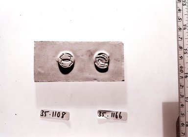 Diskoid Seal or Stamp. Steatite, glazed, Diam. 11/16 in. (1.8 cm). Brooklyn Museum, Gift of Theodora Wilbour from the collection of her father, Charles Edwin Wilbour, 35.1166. Creative Commons-BY