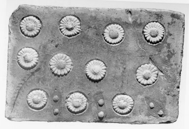 Tile with Floral Inlays, ca. 1352-1336 B.C.E. Faience, 4 3/8 x 1/4 x 6 1/2 in. (11.1 x 0.7 x 16.5 cm). Brooklyn Museum, Gift of the Egypt Exploration Society, 35.2001. Creative Commons-BY