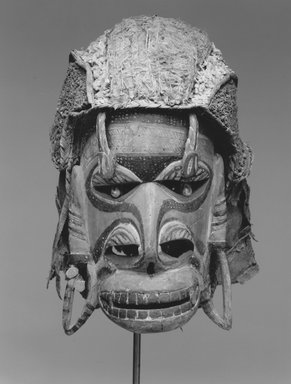 Mask (Tatanua), 19th century. Wood, bark, fiber, Turbo petholatus opercula, pigment, 12 1/4 x 8 x 10 1/2 in. (31.1 x 20.3 x 26.7 cm). Brooklyn Museum, Gift of Russell Sturgis, 35.2212. Creative Commons-BY