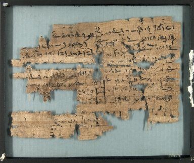 Papyrus Fragments Inscribed in Demotic, 664-404 B.C.E. Papyrus, pigment, Glass: 10 1/16 x 12 3/16 in. (25.5 x 31 cm). Brooklyn Museum, Gift of Theodora Wilbour, 35.659
