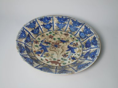 Large Plate, 17th century. Ceramic, Kubachi ware; fritware, painted in olive green, cobalt blue and green with red and yellow slips under a transparent glaze, 2 1/2 x 13 9/16 in. (6.4 x 34.4 cm). Brooklyn Museum, Gift of Frank L. Babbott, 35.677. Creative Commons-BY