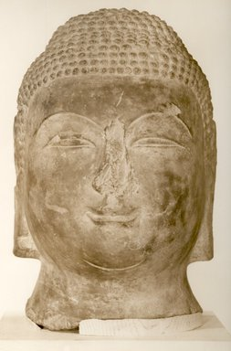 Large Head of a Buddha, 618-906. Limestone, 14 3/16 x 9 1/16 x 10 5/8 in. (36 x 23 x 27 cm). Brooklyn Museum, Caroline H. Polhemus Fund, 36.272. Creative Commons-BY