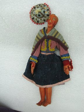 Female Doll, ca. 1936. Leather, wool, cotton, sequins, 10 1/4 x 2 9/16 in. (26 x 6.5 cm). Brooklyn Museum, Gift of Dr. John H. Finney, 36.689. Creative Commons-BY