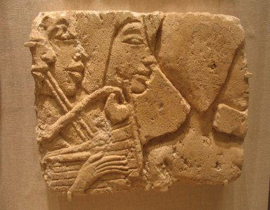 Block of a Series of Musicians in Sunk Relief, ca. 1352-1336 B.C.E. Limestone, painted, 9 1/4 x 5 1/8 x 10 1/2 in. (23.5 x 13 x 26.7 cm). Brooklyn Museum, Gift of the Egypt Exploration Society, 36.882. Creative Commons-BY