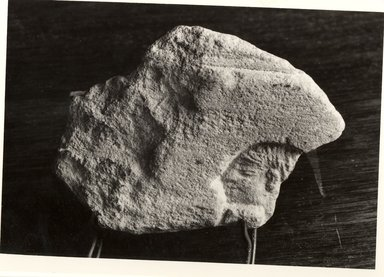 Small Flake Containing the Head of a Man in Deep Relief, ca. 1352-1336 B.C.E. Limestone, painted, 1 5/8 x 2 3/16 in. (4.1 x 5.6 cm). Brooklyn Museum, Gift of the Egypt Exploration Society, 36.963. Creative Commons-BY