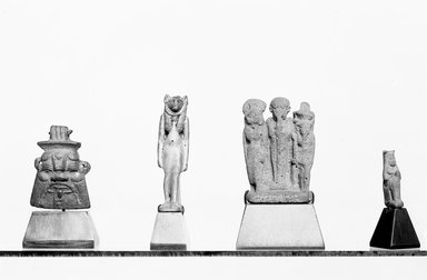 Memphite Triad with Inscribed Plinth. Frit, 1 7/16 x 1 x 9/16 in. (3.6 x 2.5 x 1.5 cm). Brooklyn Museum, Charles Edwin Wilbour Fund, 37.941E. Creative Commons-BY