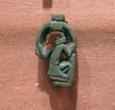 Amulet of the Deity Heh Holding Signs for Millions of Years, ca. 945-718 B.C.E. Faience, glazed, 1 9/16 x 7/8 x 1/4 in. (3.9 x 2.2 x 0.6 cm). Brooklyn Museum, Charles Edwin Wilbour Fund, 37.1169E. Creative Commons-BY