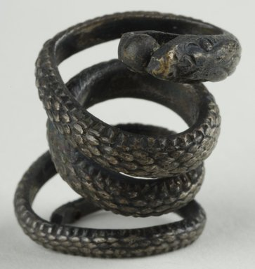 Coiled Serpent. Bronze plated with silver, 3/16 x 1 3/16 in. (0.5 x 3 cm). Brooklyn Museum, Charles Edwin Wilbour Fund, 37.1214E. Creative Commons-BY