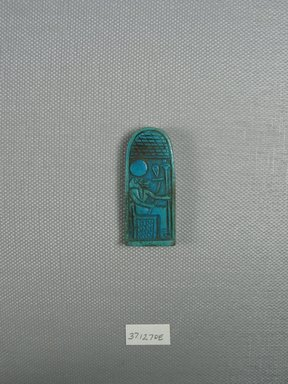 Amulet. Faience, glazed, 1 3/4 x 3/4 x 3/16 in. (4.5 x 1.9 x 0.5 cm). Brooklyn Museum, Charles Edwin Wilbour Fund, 37.1270E. Creative Commons-BY