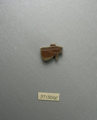 Eye Amulet, 664–332 B.C.E. Faience, glazed, 5/8 x 3/16 x 7/8 in. (1.6 x 0.5 x 2.2 cm). Brooklyn Museum, Charles Edwin Wilbour Fund, 37.1302E. Creative Commons-BY
