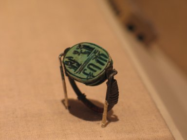 Signet Ring, ca. 1152-1145 B.C.E. Bronze, glazed steatite, 1 1/8 x 1 x 1/2 in. (2.9 x 2.5 x 1.3 cm). Brooklyn Museum, Charles Edwin Wilbour Fund, 37.1338E. Creative Commons-BY