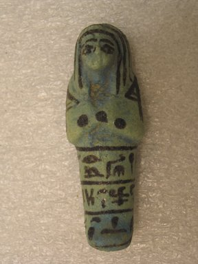 Small Mummiform Ushabti of Mwt'htp't, ca. 1075-656 B.C.E. Faience, glazed Brooklyn Museum, Charles Edwin Wilbour Fund, 37.139E. Creative Commons-BY