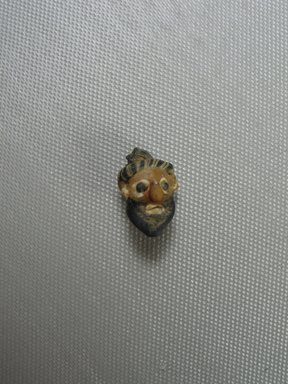 Phoenician. Head Pendant, 4th century B.C.E. Glass, 9/16 x 7/8 in. (1.5 x 2.3 cm). Brooklyn Museum, Gift of Carl Wynn Browne, 37.141. Creative Commons-BY