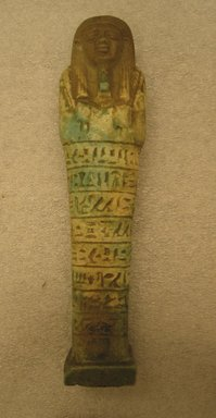 Shabty of Psamtek, 664-525 B.C.E. Faience, 7 1/16 x 1 3/4 x 1 1/4 in. (18 x 4.4 x 3.1 cm). Brooklyn Museum, Charles Edwin Wilbour Fund, 37.164E. Creative Commons-BY