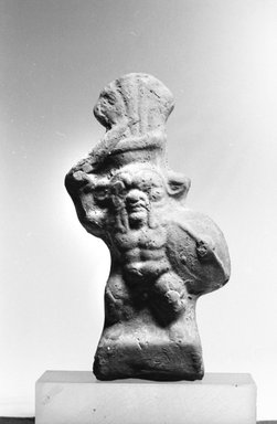 Small Figure of Bes as a Warrior, 30 B.C.E. - 395 C.E. Terracotta, slip, 4 5/16 x 2 3/4 x 1 in. (11 x 7 x 2.5 cm). Brooklyn Museum, Charles Edwin Wilbour Fund, 37.1712E. Creative Commons-BY