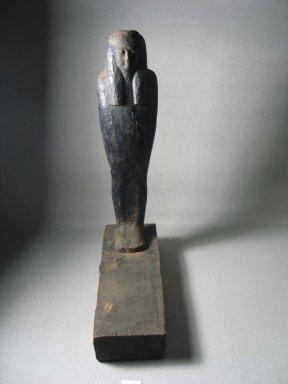 Mummiform Figure. Wood, 14 9/16 x 3 9/16 x 10 3/8 in. (37 x 9 x 26.4 cm). Brooklyn Museum, Charles Edwin Wilbour Fund, 37.1717E. Creative Commons-BY