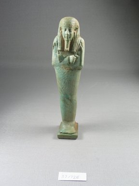 Ushabti of Psamtik-men, 664-332 B.C.E. Faience, 7 3/8 x 1 3/4 x 1 1/16 in. (18.7 x 4.5 x 2.7 cm). Brooklyn Museum, Charles Edwin Wilbour Fund, 37.172E. Creative Commons-BY