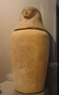 Canopic Jar and Human-Headed Lid, ca.1539-1353 B.C.E. Limestone, clay, paint, Other (A): 10 1/4 x 4 5/16 in. (26.1 x 11 cm). Brooklyn Museum, Charles Edwin Wilbour Fund, 37.1733Ea-b. Creative Commons-BY