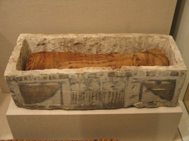 Sarcophagus and Cat Mummy, 305 B.C.E.-1st century C.E. Limestone, animal remains, linen, 37.1841Eb (Mummy): 18 1/2 x 1 15/16 x 3 1/2 in. (47 x 5 x 8.9 cm). Brooklyn Museum, Charles Edwin Wilbour Fund, 37.1841Ea-b. Creative Commons-BY