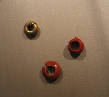 Penannular Earring, ca. 1479-1400 B.C.E. Jasper, 7/16 x Diam. 3/4 in. (1.1 x 1.9 cm). Brooklyn Museum, Charles Edwin Wilbour Fund, 37.1955E. Creative Commons-BY