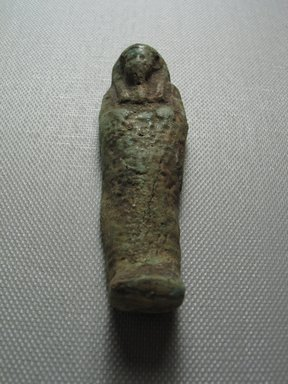 Ushabti of Yuf-o, 664-343 B.C.E. Faience, 3 1/4 x 7/8 x 1/2 in. (8.3 x 2.3 x 1.3 cm). Brooklyn Museum, Charles Edwin Wilbour Fund, 37.233E. Creative Commons-BY