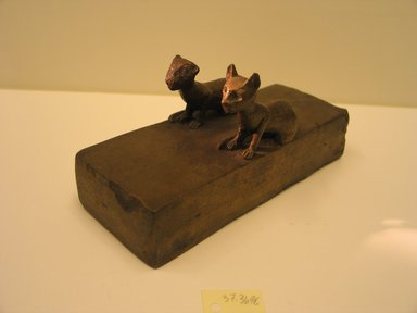 Kitten Coffin, 850-540 B.C.E. Bronze, animal remains (2 individuals), linen, 3 1/8 x 2 3/8 x 6 1/4 in. (8 x 6 x 15.8 cm). Brooklyn Museum, Charles Edwin Wilbour Fund, 37.369Ea-b. Creative Commons-BY