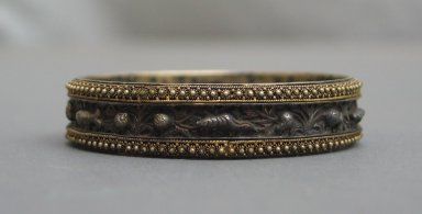 Pair of Bracelets. Silver gilt, .2: 9/16 x 2 11/16 in. (1.5 x 6.8 cm). Brooklyn Museum, Frank L. Babbott Fund, 37.371.130.1-.2. Creative Commons-BY