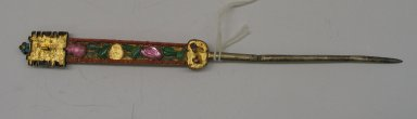 Hair Pin, Early 20th century. Gilt silver, kingfisher feather, pink tourmaline, jade, coral, garnet, 7 15/16 x 13/16 in. (20.2 x 2 cm). Brooklyn Museum, Frank L. Babbott Fund, 37.371.251. Creative Commons-BY