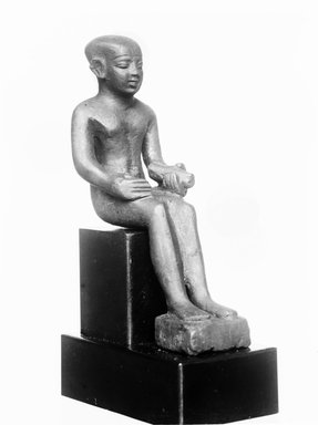 Small Statue of Imhotep. Bronze, 3 7/8 x 1 1/8 x 1 7/8 in. (9.8 x 2.9 x 4.8 cm). Brooklyn Museum, Charles Edwin Wilbour Fund, 37.374E. Creative Commons-BY