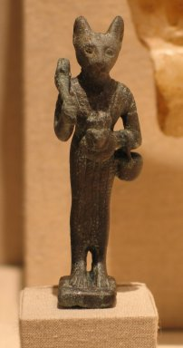 Small Figurine of the Goddess Bast, 305-30 B.C.E. Bronze, 3 5/16 x 1 1/8 x 3/4 in. (8.4 x 2.9 x 1.9 cm). Brooklyn Museum, Charles Edwin Wilbour Fund, 37.376E. Creative Commons-BY