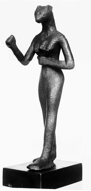 Small Figurine of the Goddess Bast. Bronze, 4 15/16 x 1 9/16 x 1 11/16 in. (12.6 x 3.9 x 4.3 cm). Brooklyn Museum, Charles Edwin Wilbour Fund, 37.378E. Creative Commons-BY