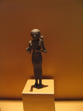 (Statue of a) Priestess of the Goddess Bastet, ca. 664-332 B.C.E. Silver with mixture of copper, 4 3/4 x 1 7/16 x 1 5/16 in. (12.1 x 3.6 x 3.4 cm). Brooklyn Museum, Charles Edwin Wilbour Fund, 37.402E. Creative Commons-BY