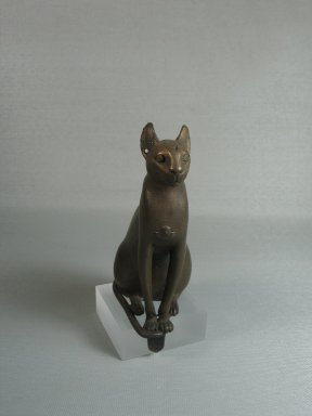Statue of a Cat. Bronze, with tang: 4 13/16 x 1 13/16 x 2 7/8 in. (12.3 x 4.6 x 7.3 cm). Brooklyn Museum, Charles Edwin Wilbour Fund, 37.426E. Creative Commons-BY