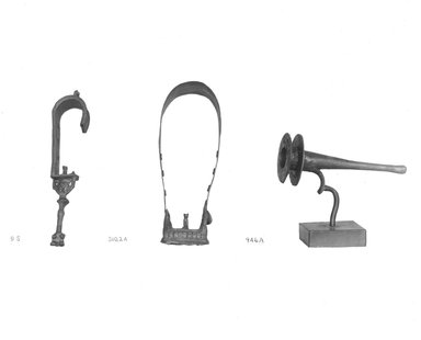Sistrum. Bronze, 5 3/4 x 1 x 1 3/8 in. (14.6 x 2.6 x 3.5 cm). Brooklyn Museum, Charles Edwin Wilbour Fund, 37.573E. Creative Commons-BY
