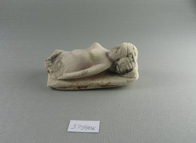 Small Figure of a Woman Lying on a Couch. Limestone, painted, 1 13/16 x 1 9/16 x 3 5/8 in. (4.6 x 3.9 x 9.2 cm). Brooklyn Museum, Charles Edwin Wilbour Fund, 37.590E. Creative Commons-BY