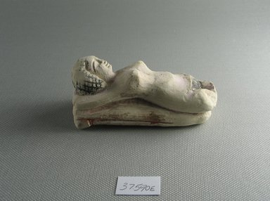 Small Figure of a Woman Lying on a Couch