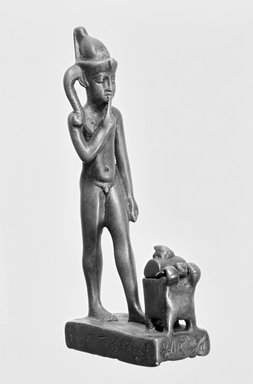 Figure of the Child Horus Standing in Front of a Small Box with Moveable Cover. Bronze, 5 1/8 x 1 1/8 x 2 3/8 in. (13 x 2.8 x 6.1 cm). Brooklyn Museum, Charles Edwin Wilbour Fund, 37.593E. Creative Commons-BY